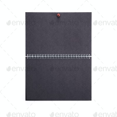Black blank wall calendar template isolated on white background.