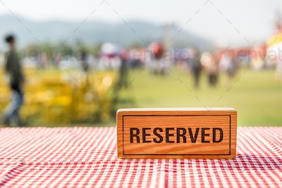 Reserved wooden sign on outdoor table in event