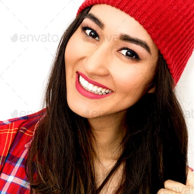 Happy brunette Girl Smile and fashion  Checkered shirt and beani