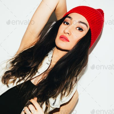Brunette model in fashion beanie cap. Urban style