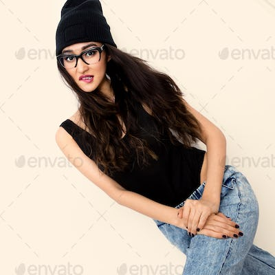 Sexy brunette Girl in black body and beanie cap. Jeans. Tomboy s