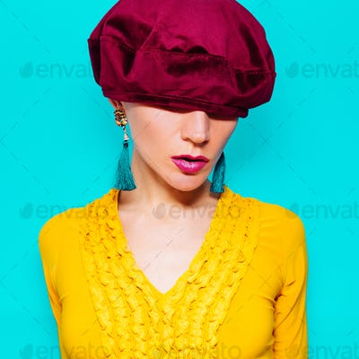 Model in fashion accessory beret and  jewelery  Vintage dress