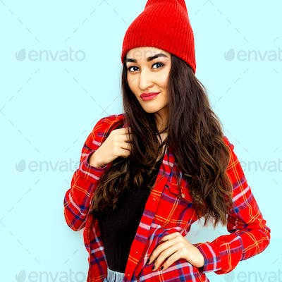 Pretty brunette Model Urban Fashion Look.  Checkered shirt and b