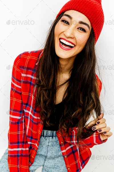 Happy brunette Girl. Smile and fashion urban vibes. Red colours