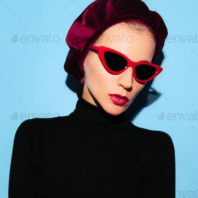 Blonde Model in a fashion accessory beret and sunglasses. Vintag