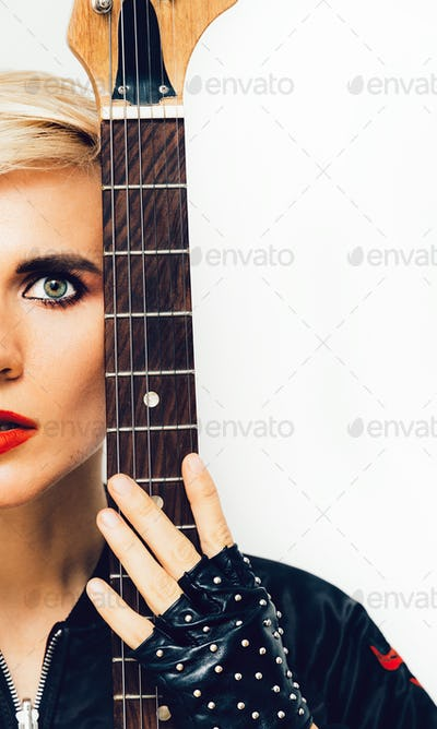 Sensual Model with electro guitar. Rock style