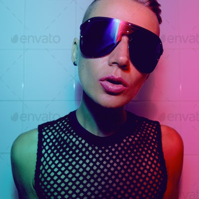 Tomboy Sexy Girl with short hair and luxury sunglasses. Fashion