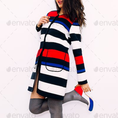 Brunette model in fashion striped coat and stylish Shoes. Lady o