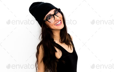 Happy brunette Model in black body and beanie cap. Stylish glass