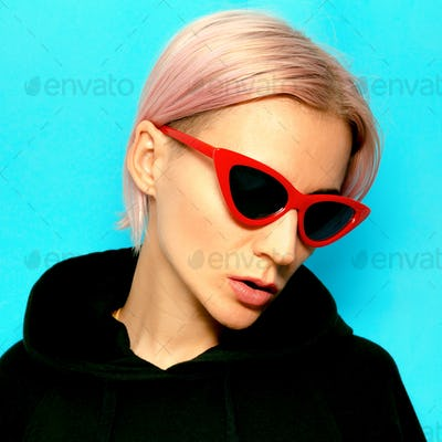 Blonde in fashionable sunglasses. Urban street style
