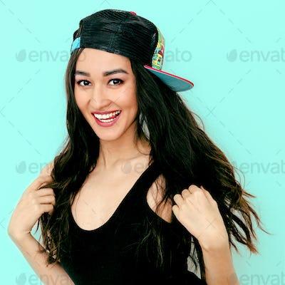 Happy teen Girl in fashion b-boy cap. Urban style