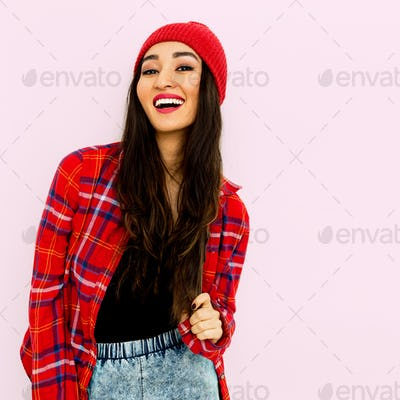 Happy brunette Girl  Fashion  Checkered shirt and beanie cap. Tr