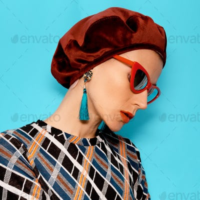 Vintage Lady in fashion accessory beret and glasses. Earrings. R