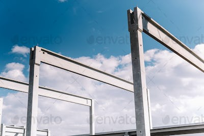 Construction site of hall, precast cement pillars and beams