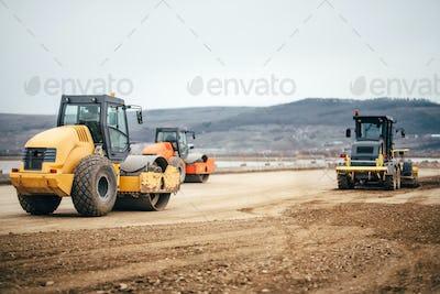 Vibratory Soil Compactors on highway construction site