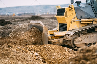 highway construction site close up with industrial machinery, excavator and bulldozer working
