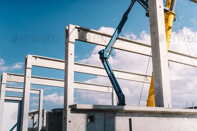 Installation of prefabricated cement pillars and beams on construction site