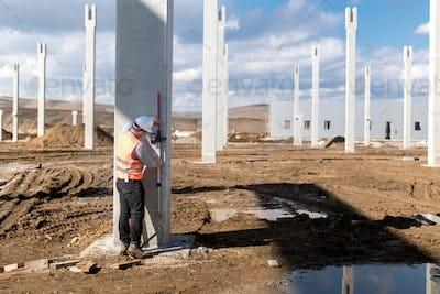 Industrial civil engineer working on construction site. Professional surveyor measuring level