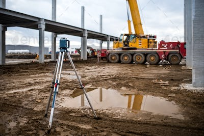 Industrial engineering with theodolite, gps, total station and tools at construction site