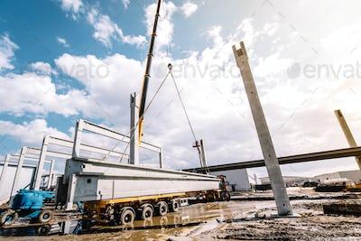 crane lifting prefabricated concrete framework, unloading and cargo details
