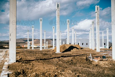 Industrial construction site with prefabricated concrete pillars