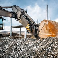 Close up details of heavy machinery excavator. Industrial scoop of excavator working on site
