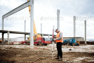 industrial civil engineer working with prefabricated cement pillars