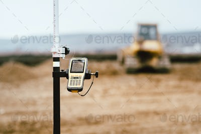 close up details of gps and theodolite in surveying industry. Construction site details