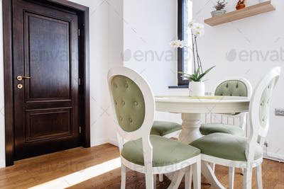 Interior design details - modern furniture, dining table with chairs in kitchen