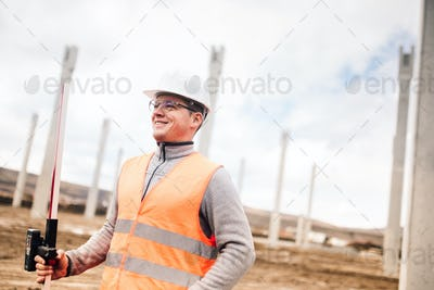 Portrait of smiling engineer on construction site