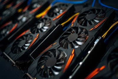 Close up details of graphics cards at cryptocurrencies mining rig. Modern technology