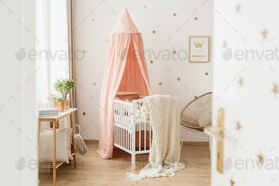 Open door to pink nursery