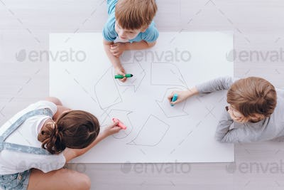 Kids drawing a poster
