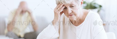 Worried and sad senior woman