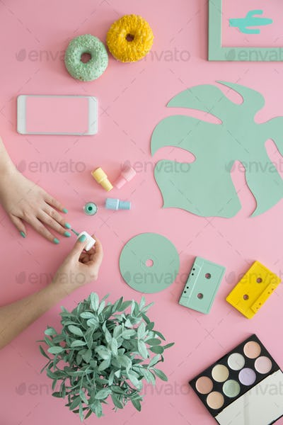 Mint leaf on pink desk