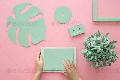 Green objects on rose background