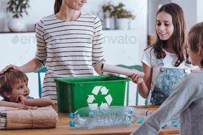 Mother teaching how to recycle