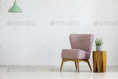 Retro chair in empty room