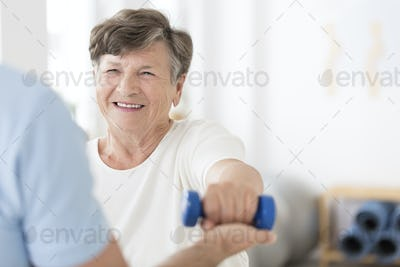 Senior woman exercising with weights
