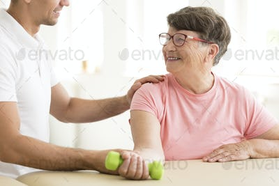 Older woman in physical rehabilitation