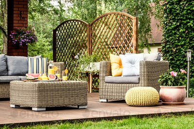 Wooden terrace with yellow pouf