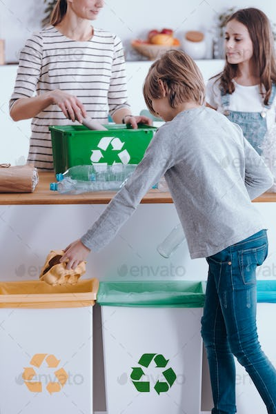 Family sorting waste