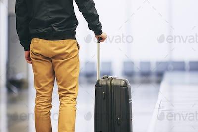 Man in airport terminal