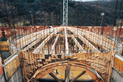 wooden arch dome being built on monastery construction site