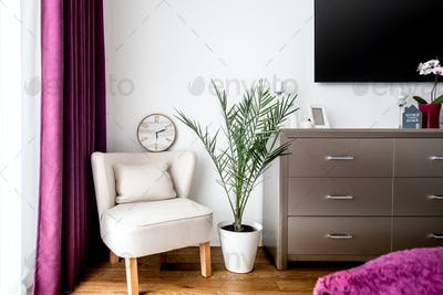 Decoration details, armchair and tv stand in modern bedroom