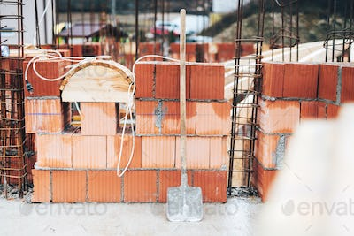 Industrial construction site with brick details and wire rod. bricklayering details
