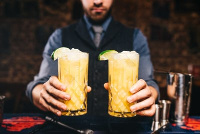 close up portrait of bartender or barman serving fresh drinks