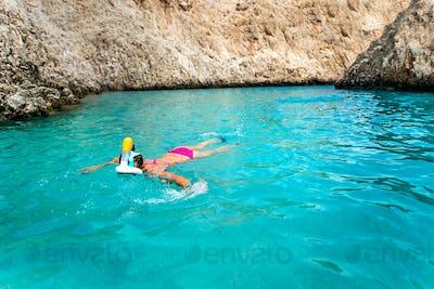Beautiful woman in bikini snorkeling in tropical sea