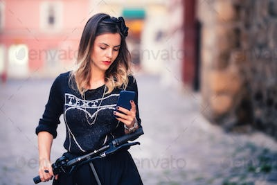 Portrait of charming woman writing text and posting on social media. Modern life details concept