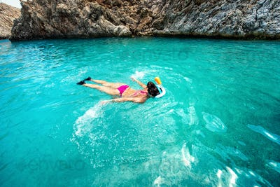 Close up of woman swimming in clear sea water, enjoying snorkeling